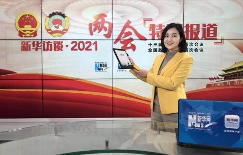 新华社两会报道黑科技——讯飞智能办公本